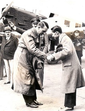 Berlin, Germany..... Two heads that bow as one, Herr Adolf Hitler, Dictator of Germany (left), bids bon voyage to King Prajadhipok of Siam, when the latter, accompanied by his queen, left Berlin following their extended visit to Germany's capital. This modern ruling family does all its traveling by airplane, while in Europe, at least.