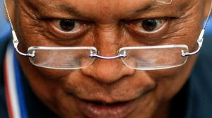 Protest leader Suthep Thaugsuban answers questions during a news conference in Bangkok